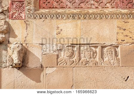 Relief with Jesus and patterns on historical wall of the Svetitskhoveli Cathedral, built in 4th century, Georgia. UNESCO World Heritage Site.