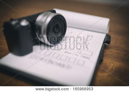 Small Digital Camera On Notepad