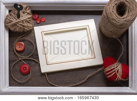 Valentines day photo frame or greeting card and handmaded hearts over wooden table. Top view with copy space