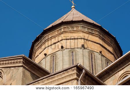 Tower with carved walls on historical Svetitskhoveli Cathedral, built in 4th century, Georgia. UNESCO World Heritage Site.
