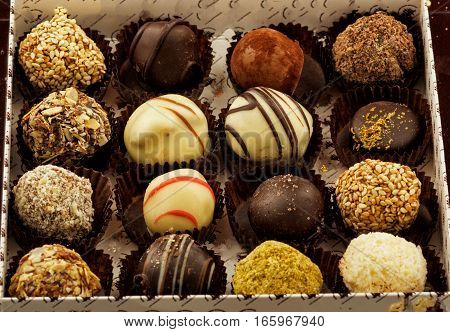 Delicious chocolate candies in gift box clouse up