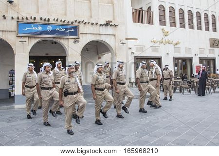 Doha, Qatar, November 25th 2016: qatar policemen doing their daily march routine outside police station in souq waqif