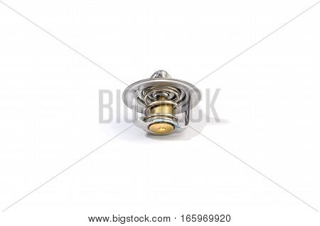 spare thermostat for a new car on a white background