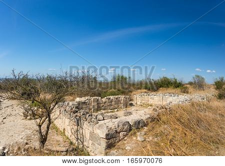 Ruins of the medieval fortress town Chufut-Kale on a hot summer day. Crimea Russia