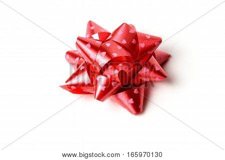 Red decoration gift ribbon star on white background isolate.