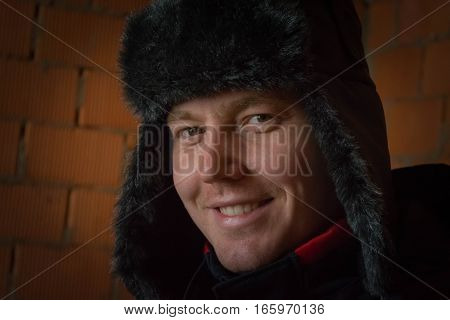 Portret of smile young guy with fur hat