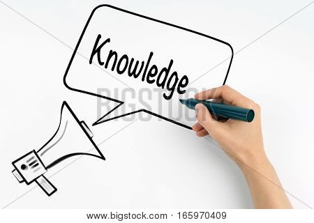 Knowledge concept. Megaphone and text on a white background.