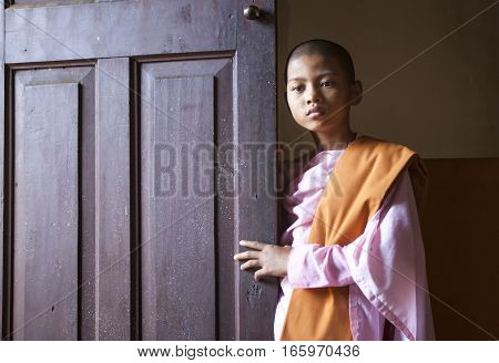 Mandalay Myanmar November 15th 2014: young buddhist nun in a monastery
