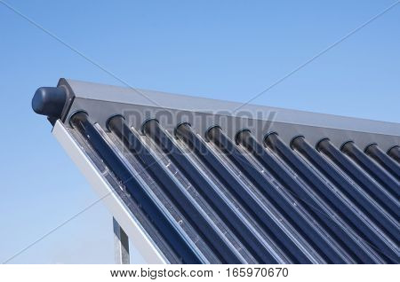 Closeup of vacuum solar water heating system on the house roof.Energy efficiency