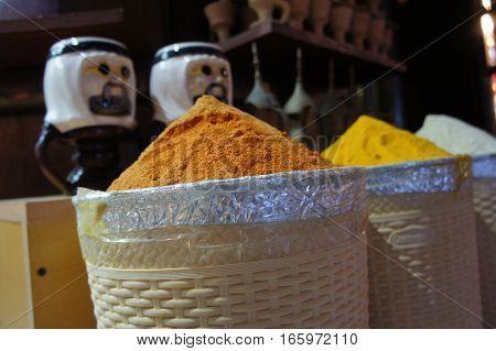 Spices on Dubai market with arabian sheik figures