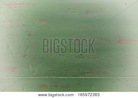 Dark Green Rustic Wood Background With White Vignette.