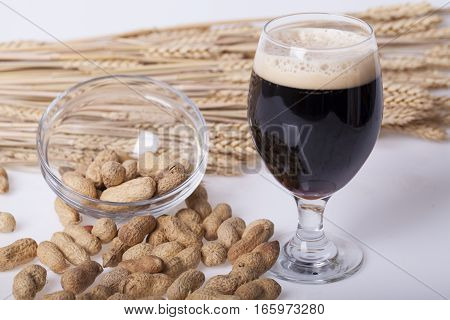 Black beer in the glass on the table Selective focus and small depth of field