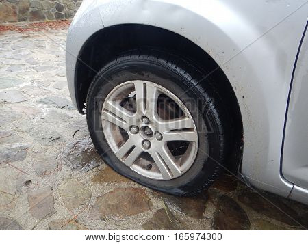 Detail Of A Flat Tire On A Car