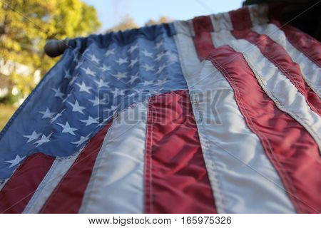 A U.S. Flag hanging from a pole