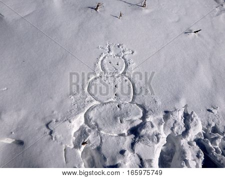 Snowman drawn in snow , snowman ,