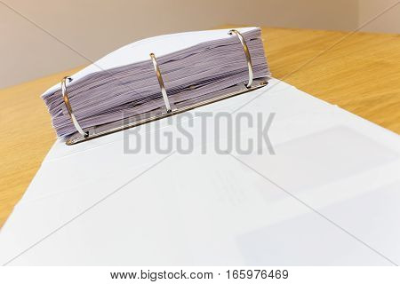 Desk in an office with folder full of papers background stock photo