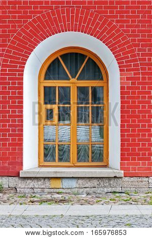 Window with arch in the background of wall of red brick. From the series window of Saint-Petersburg.