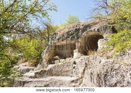Medieval cave city-fortress Chufut-Kale Bakhchysarai Republic of Crimea Russia. Carved into the rock of the premises