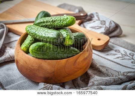 Fresh Cucumbers In A Wooden Bowl.