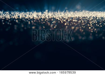 Glitter lights abstract background. Defocused bokeh dark illustration