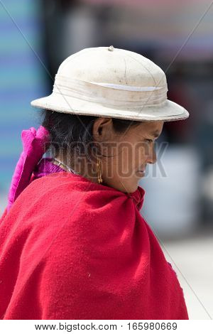 July 24 2016 Alausi, Ecuador: indigenous woman in traditional wear outdoor portrait in the small Andean town