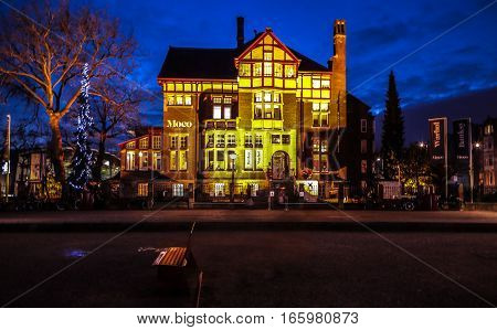 AMSTERDAM NETHERLANDS - DECEMBER 31 2016: City sights of Amsterdam at night. General views of city landscape. on December 31 2016 in Amsterdam - Netherland.
