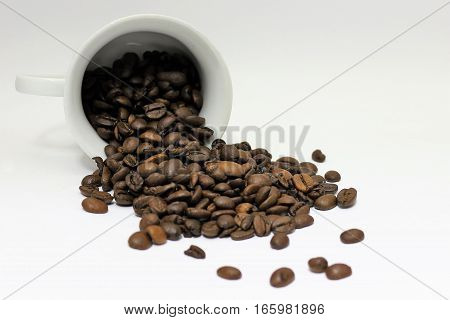 cup spilled coffee beans roasted brown background isolated
