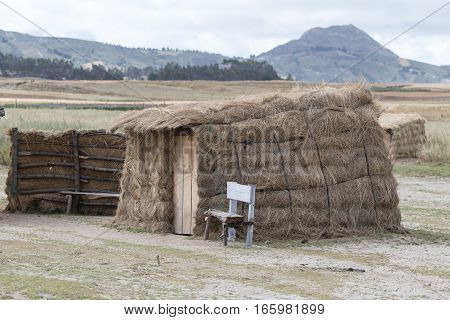 small indigenous shacks made of hay are common in the isolated highlands of Ecuador