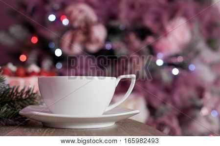 White tea cup on a table with blurred background