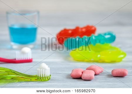 prevention and care for children's teeth on wooden background top view.