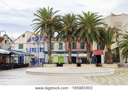 VODICE, CROATIA - SEPTEMBER 5, 2016: This is quay resort with palm trees standing alone.