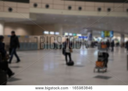 Blurred Image Bokeh Of People Walking In The Airport.