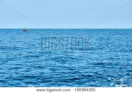 Man Sailing In The Ocean