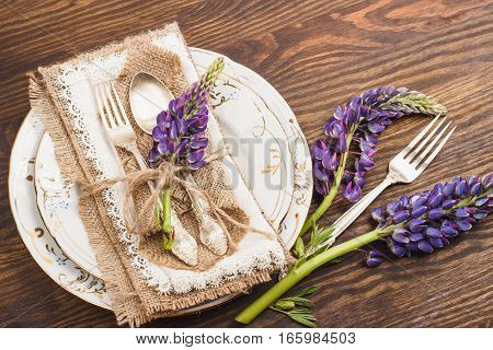 Violet Lupins And Tableware On The Wooden Table