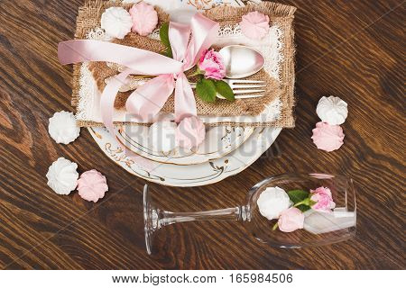 Light Pink Roses And Tableware On The Wooden Table
