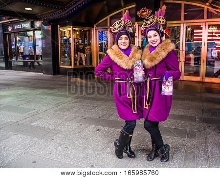 New York NY USA - January 20 2016: Girls take time out to pose as they hand out flyers for the play