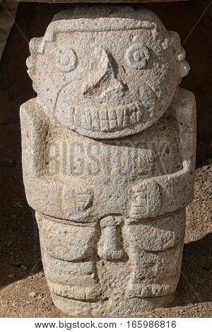 closeup details of a pre-columbian stone statue in the San Agustin archaeological park in Colombia