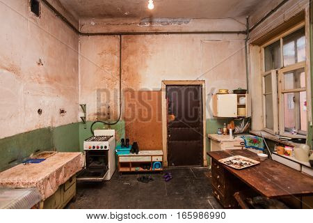Dirty kitchen is in the temporary apartment for living (existence) refugees