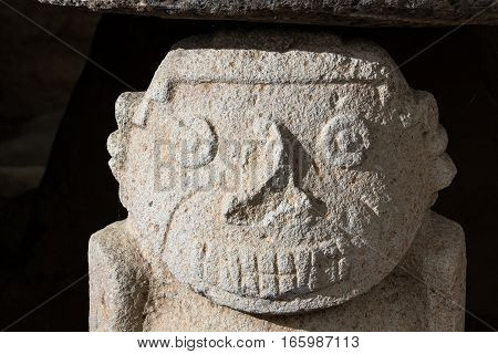 pre-columbian stone statue closeup details in Altos de los Idolos archaeology site in Colombia