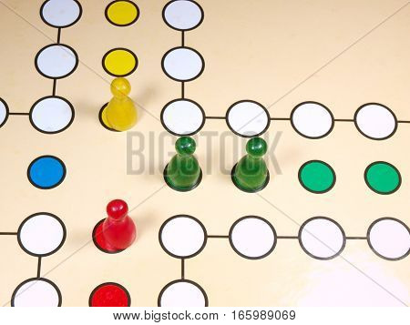 Children board game with colored  pawns origin from India