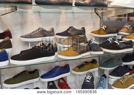 Variety of men's shoes in the shop window. Sale