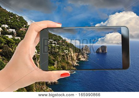 Tourist taking a picture of an amazing landscape on Amalfi Coast, Italy