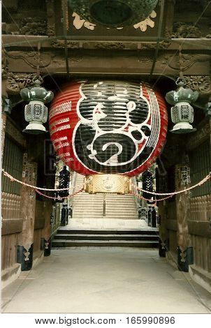 NARITA, CHIBA / JAPAN - CIRCA NOVEMBER, 1987: A large red ball decorates the Niomon Gate in the Narita-san Shinshō-ji Shingon Buddhist temple.
