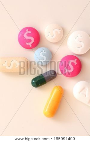 Healthcare cost concept with multicolored medical drugs with us dollar symbol