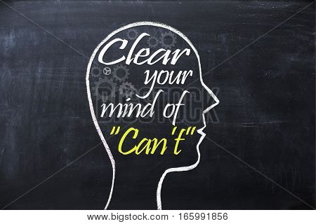 Clear your mind of can't phrase inside human head shape drawn on chalkboard