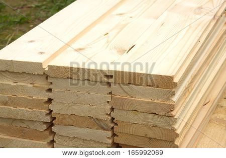 Rows of many planed planks outdoor close-up