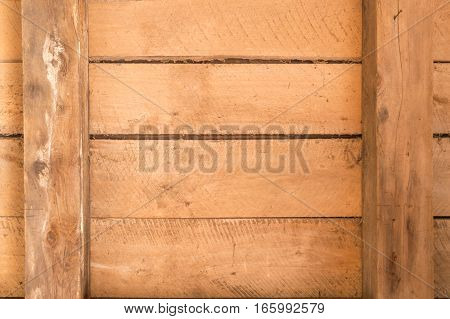 Wooden boards inside an old outbuilding with beams and horizontal arrangement