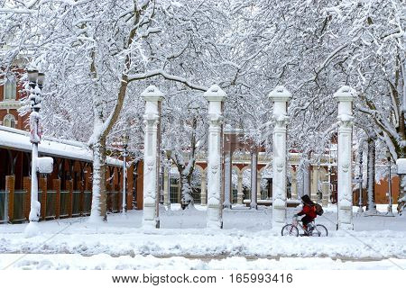 PORTLAND OR - JANUARY 11: Bicycle passes through the snow past Ankeny Square in downtown Portland OR on January 11 2017