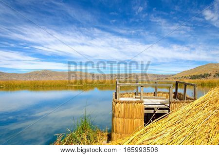 Viewpoint on one of the Uros Floating Islands on Lake Titicaca in Peru with Puno visible in the background