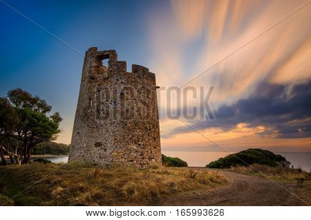 Saracen tower Torre di Cala on Sardegna near Cagliari at sunset Italy